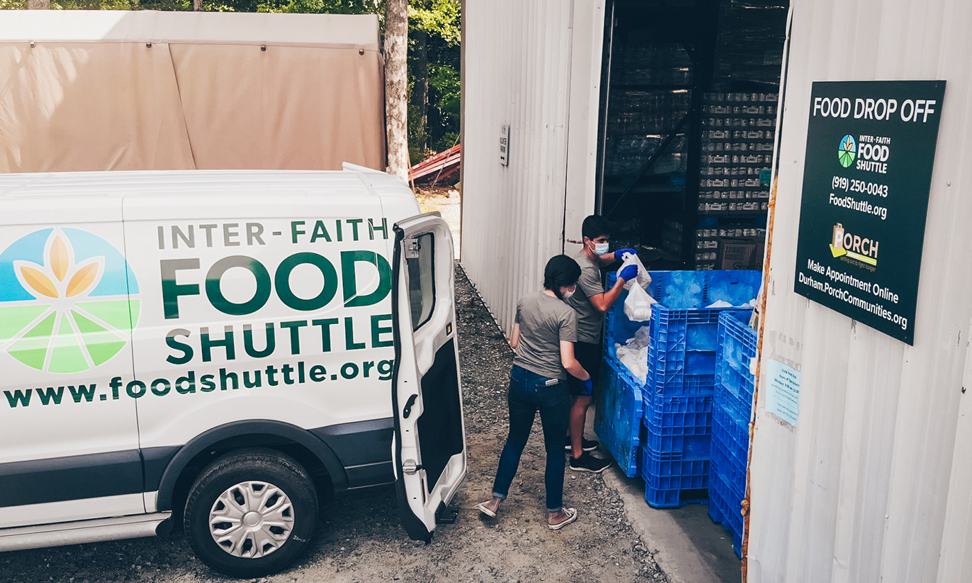 Two People Loading Inter-Faith Food Shuttle Van
