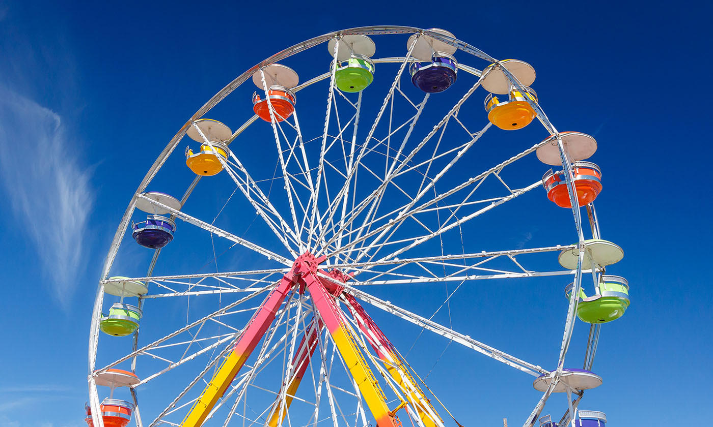 Brightly Colored Ferris Wheel Against a Blue Sky