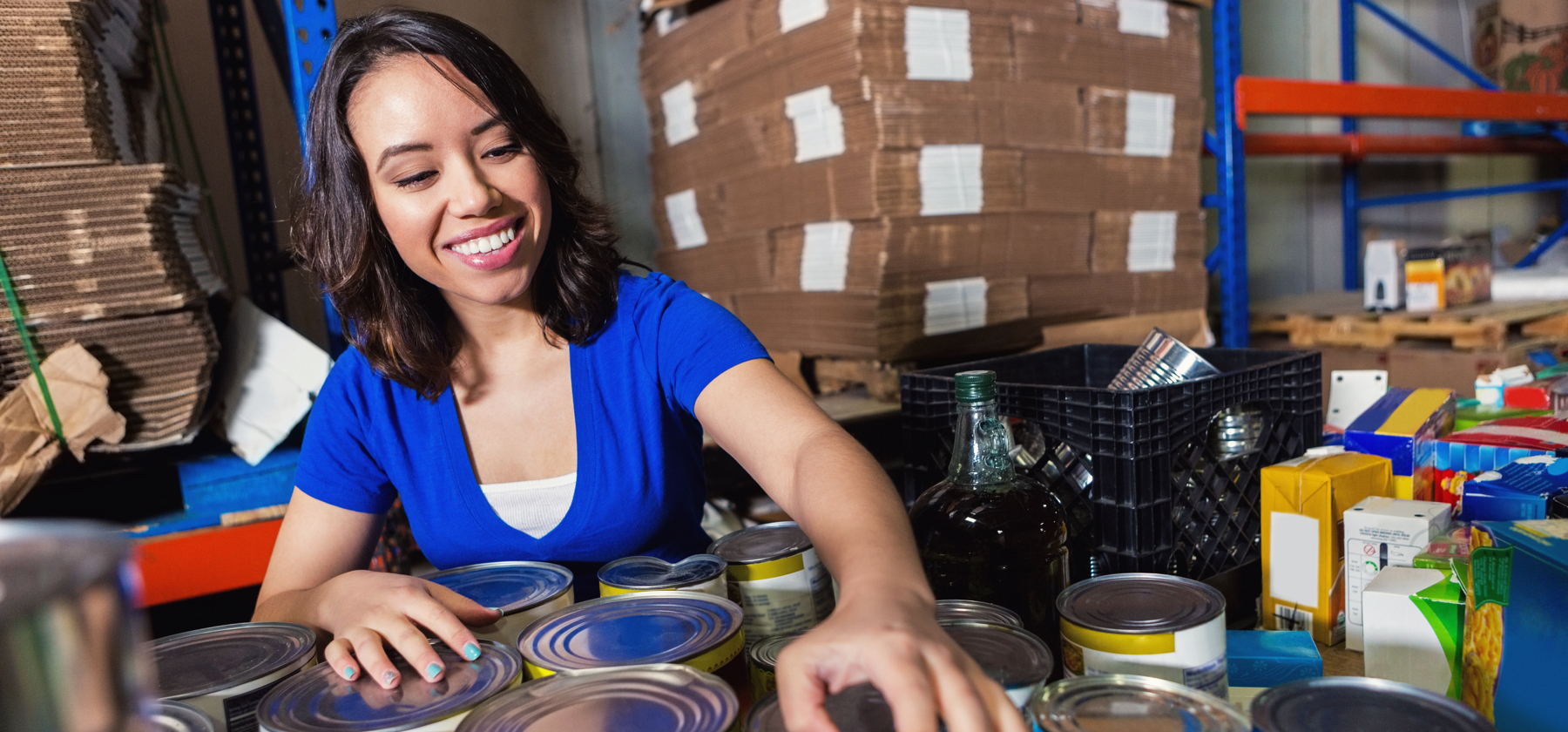 Stock Photo of Woman Sorting Canned Goods After Pepsi Donates to Stop Summer Hunger Campaign & Food Bank of NC