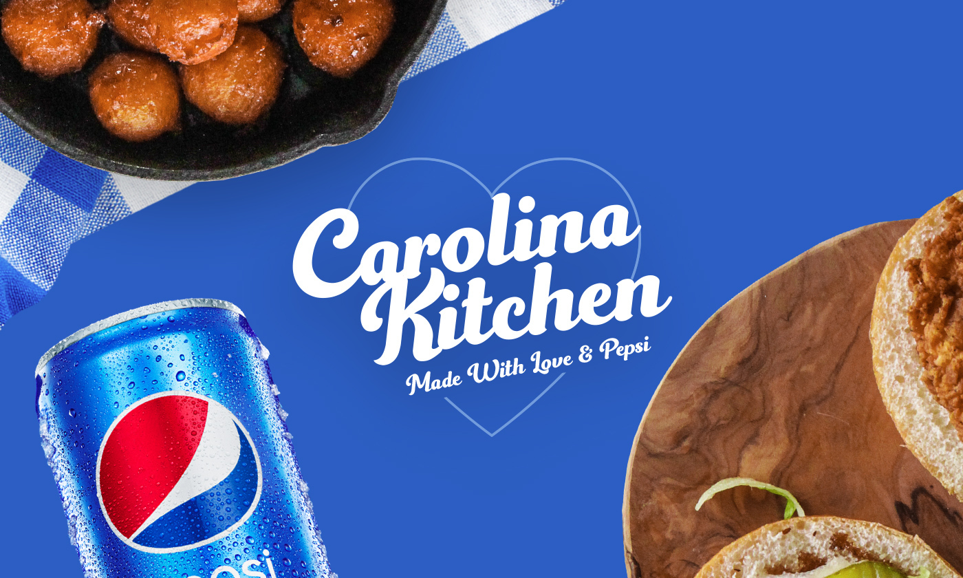 Blue Background with Carolina Kitchen Title, Pepsi Can, Sandwich on a Board and Skillet of Hush Puppies