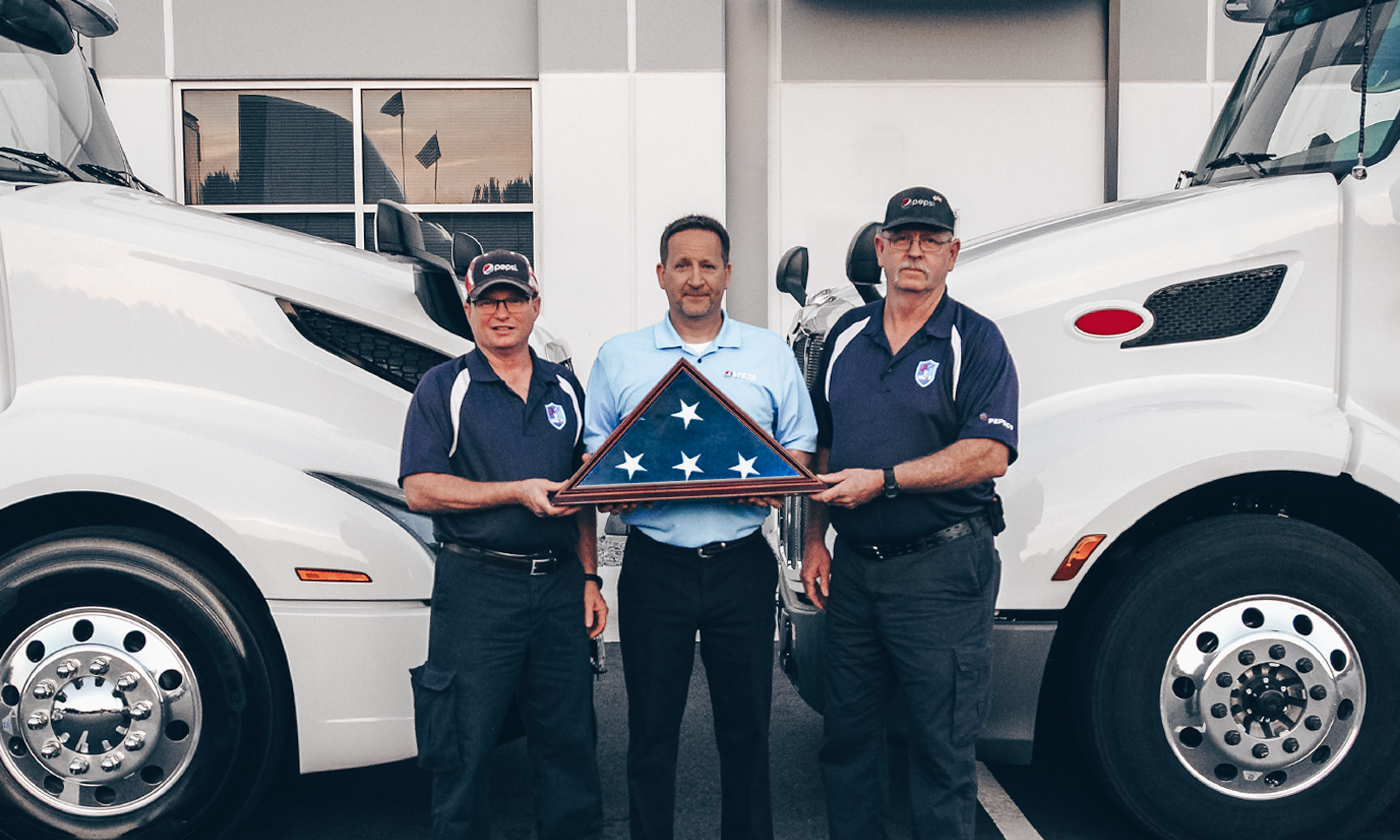 US Veteran Military drivers from Pepsi carry flag across country