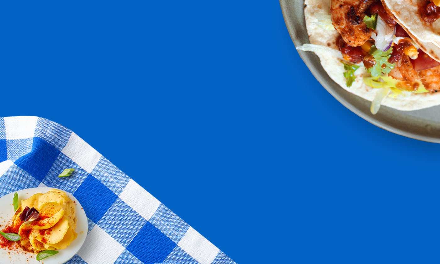 Plated Eggs and Tacos with Blue Background